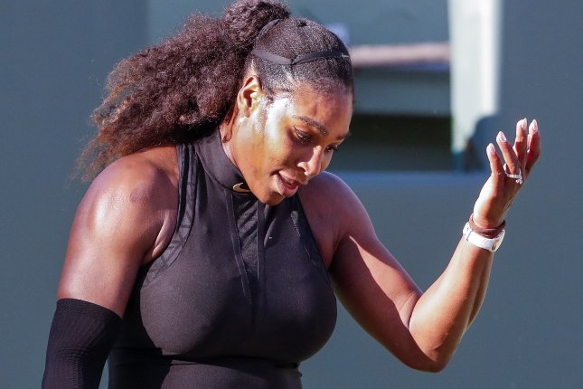 Serena Williams reacts against Naomi Osaka of Japan during a first round match Wednesday at the Miami Open tennis tournament on Key Biscayne in Miami, Fla. Photo by Erik Lesser/EPA-EFE