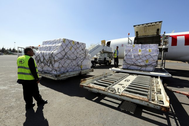 Workers unload emergency medical aid of 1.9 million doses of vaccines supplied by UNICEF at Sana'a International Airport. Photo by Yahya Arhab/EPA-EFE