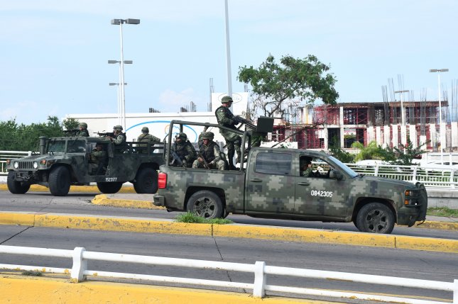 Armed groups and federal police battle in Culiacan, Mexico, on October 17 -- after the attempted arrest of Ovidio Guzman Lopez, the son of convicted drug kingpin Joaquin El Chapo Guzman. Photo by El Debate/EPA-EFE