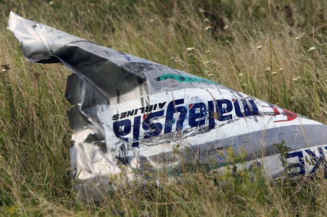 Part of the wreckage of Malaysia Airlines Flight MH17 is seen near Grabovo, Ukraine, on July 20, 2014. File Photo by Igor Kovalenko/EPA-EFE
