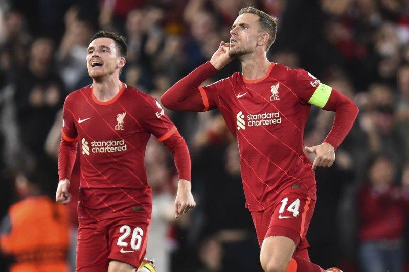 Champions League soccer: Salah, Henderson lead Liverpool over AC Milan