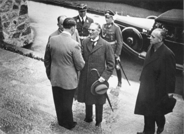 German leader Adolf Hitler greets British Prime Minister Neville Chamberlain on the steps of The Berghof, near Berchtesgaden, on September 15, 1938. File Photo courtesy Das Bundesarchiv
