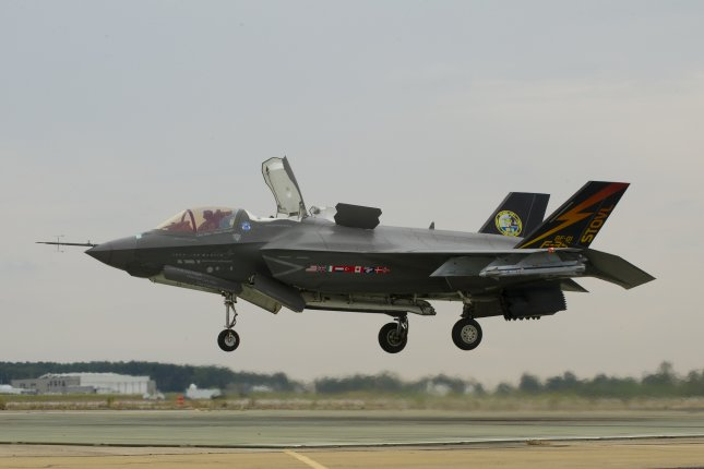 An F-35B test aircraft executes a vertical landing at Naval Air Station Patuxent River, Md., in September 2013. The aircraft carried two AIM-9X test weapons on its wings. Photo courtesy of Lockheed Martin