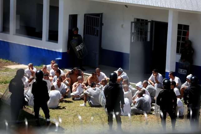 Guatemala's Etapa II youth detention center inmates, who attempted to escape, surrender to police officers in San José Pinula, Guatemala, on Monday. Guatemala's interior minister said security forces were able to take control and rescue several guards held hostage without firing a single bullet. File Photo by Esteban Biba/EPA