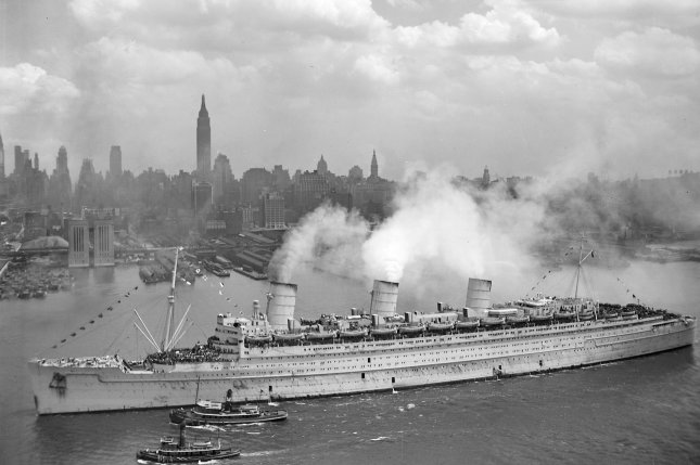 The British liner RMS Queen Mary arrives in New York harbor on June 20, 1945, with thousands of U.S. troops from Europe. File Photo courtesy U.S. Navy