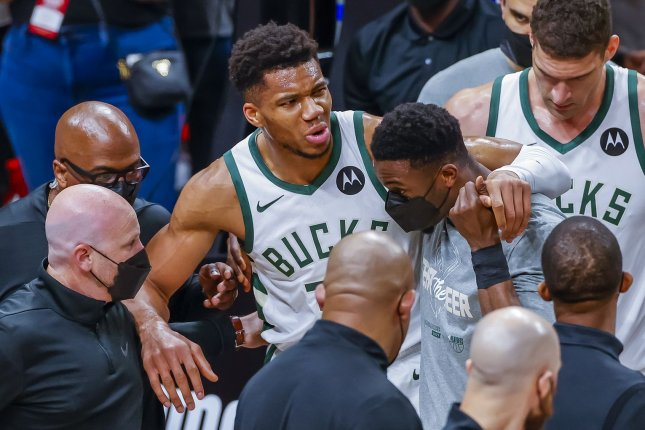 Milwaukee Bucks forward Giannis Antetokounmpo (C) suffered a hyperextended left knee during Game 4 of the Eastern Conference Finals on June 29. He has been out of the lineup since the injury. File Photo by Erik S. Lesser/EPA-EFE