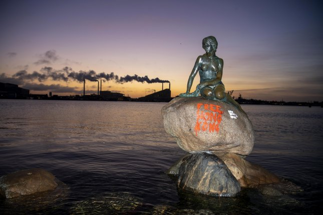 Free Hong Kong appears on The Little Mermaid statue in Copenhagen, Denmark, Monday. Photo by Thomas Sjoerup/EPA-EFE