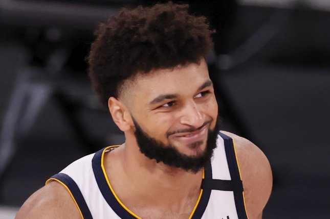 Denver Nuggets guard Jamal Murray scored 16 points before he was ejected in the third quarter of a win over the Dallas Mavericks on Monday in Dallas. Photo by Erik S. Lesser/EPA-EFE
