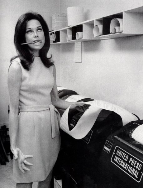 Mary Tyler Moore is shown ripping UPI copy off a teletype in her television show in an undated file photo. The beloved actress died Wednesday at the age of 80. File Photo by UPI