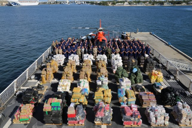 The Coast Guard Cutter James crew stands aboard the vessel Tuesday in Port Everglades, Florida, where they are scheduled to offload nearly 40,000 pounds of narcotics. Photo by Seaman Erik Villa Rodriguez/U.S. Coast Guard