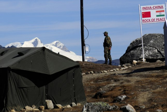 An Indian soldier is seen on duty at the Line of Control at the India-China international border in Bumla, Arunachal Pradesh State, India. File Photo by EPA-EFE