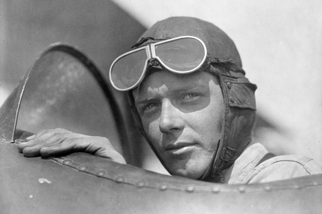 Aviator Charles Lindbergh, wearing a helmet and goggles, is pictured in the open cockpit of airplane at Lambert Field, in St. Louis, Mo., ca. 1920s. File Photo by Library of Congress/UPI