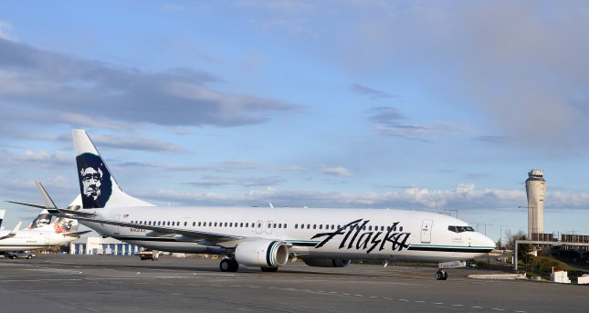 An Alaskan Airlines Boeing 777-900 aircraft is parked on a runway. On Tuesday, a former Alaskan Airlines pilot pleaded guilty to flying while intoxicated. Photo courtesy Alaskan Airlines