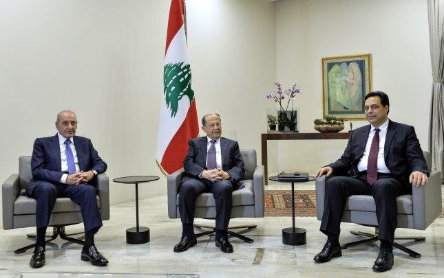 Lebanese President Michel Aoun, Prime Minister Hassan Diab and Parliament Speaker Nabih Berri met at the presidential palace on Tuesday after designating a new government made up of 20 ministers. Photo by Wael Hamzeh