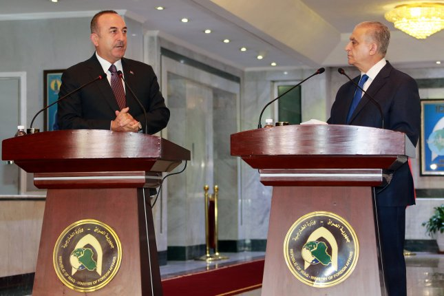 Turkish Foreign Minister Mevlut Cavusoglu (L) speaks during a press conference with his Iraqi counterpart Mohamed Ali Alhakim at the Iraqi Ministry of Foreign Affairs in Baghdad, Iraq, on Sunday. Cavusoglu said Turkish President Recep Tayyip Erdogan will visit Iraq by the end of the year and Iraqi Prime Minister Adel Abdul Mahdi will also visit Turkey. Photo by Ahmed Jalil/EPA