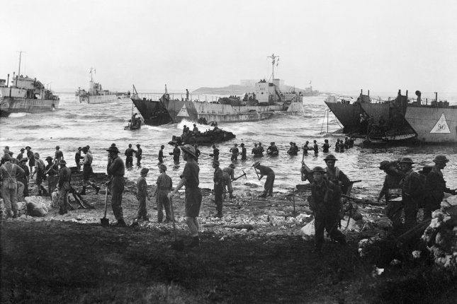 Troops from the 51st Highland Division unload stores from tank landing craft on during the Allied invasion of Sicily, on July 10, 1943. On July 9, 1943, U.S., Canadian and British forces invaded Sicily during World War II. File Photo courtesy of the Royal Navy
