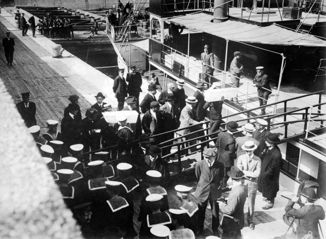 Sailors are pictured removing coffins from the Lady Gray at port in Quebec following the sinking of the RMS Empress of Ireland ocean liner on May 28, 1914. More than 1,000 people died in the incident. File Photo by Library of Congress/UPI