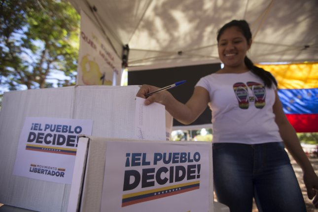 The Venezuelan community in the Brazilian city of Brasilia votes in an unofficial poll organized by the Venezuelan political opposition on July 16. On Thursday, Venezuela's ruling party agreed to delay elections until May 20, but some opposition parties still plan to boycott. File Photo by Joedson Alves/EPA