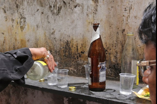 Over 100 people die in India after drinking spurious alcohol