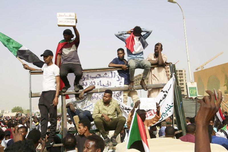 Sudanese people celebrate the reported ouster of President Omar al-Bashir in Khartoum, Sudan, on Thursday. Photo by EPA-EFE