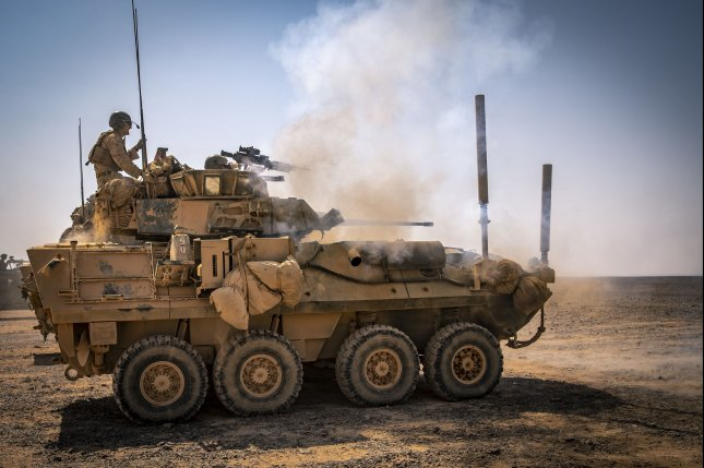 A light armored vehicle 25 is pictured firing its main gun during Exercise Eager Lion 19 in Jordan in September 2019. Photo by Sgt. Adam Dublinske/U.S. Marine Corps