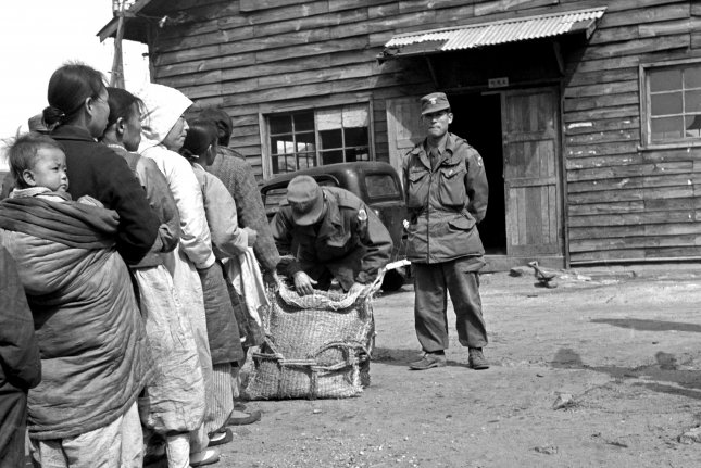 Organized by the United Nations Civil Assistance Command, the distribution of a daily ration of rice to the population of Seoul started three days after the liberation of the city on March 17, 1951. Long lines of old men, women and children formed outside the police stations to take their ration of less than a pound per person. File Photo United Nations/UPI