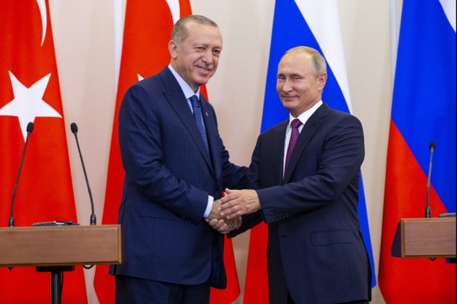 Turkish President Recep Tayyip Erdogan said he hopes cooperation with the Russian leader will ease fighting in the contested northwestern Syria territory. File Photo by Alexander Zemlianichenko/EPA-EFE