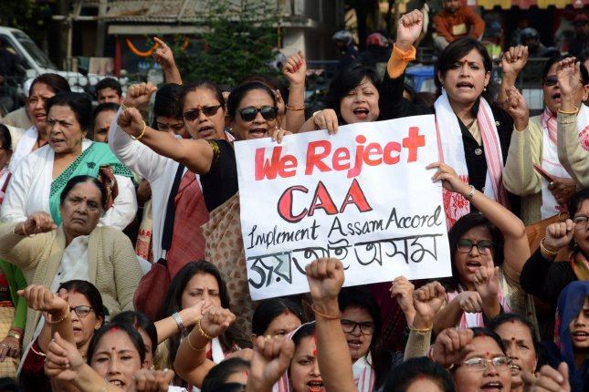 Indian women shout slogans during a protest against the Citizenship Amendment Act in Guwahati, India, on December 21. File Photo by EPA-EFE