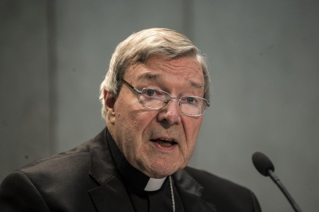 Australian Cardinal George Pell speaks to members of the media at the Vatican on Thursday. Cardinal Pell, 76, Australia's most senior Catholic, has been charged with multiple counts of historical sexual assault offenses. Photo by Massimo Percossi/EPA