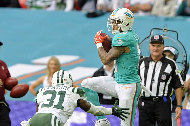 a524eca3922 Miami Dolphins wide receiver Kenny Stills (R) scores a touchdown against  the New York Jets with Antonio Cromartie (L) during their NFL International  series ...