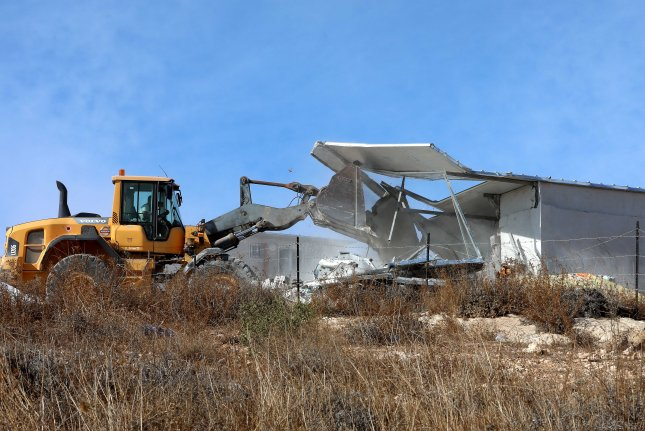 An Israeli bulldozer demolishes a house in the West bank area of Masafer on November 21, 2019. Israel on a regular basis demolishes Palestinian homes in the West Bank citing missing building permits for Area C. File Photo by Abed al Hashlamoun/EPA-EFE