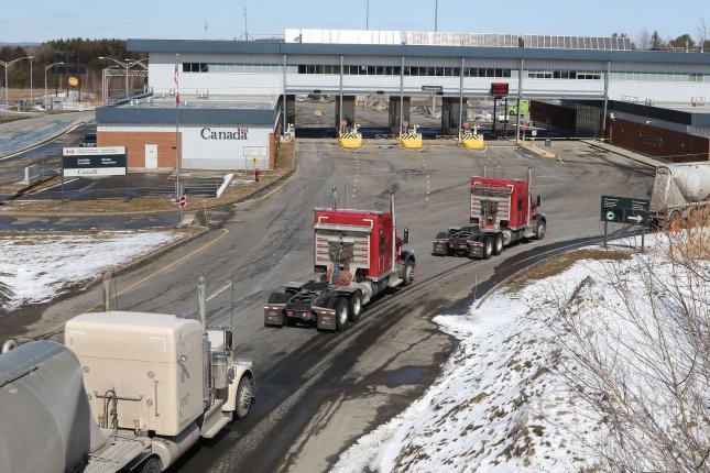 Vehicles line up at the border between the United States and Canada in Derby, Vt., on March 18, 2020, shortly after the border was initially closed due to COVID-19. File Photo by Herb Swanson/EPA-EFE