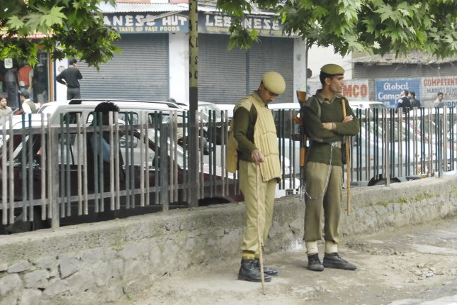 Police officers in Srinagar, Indian-administered Kashmir. The disputed region near the Himalayas has been the site of conflict between residents and Indian government since July. File Photo by Vlad Karavaev/Shutterstock