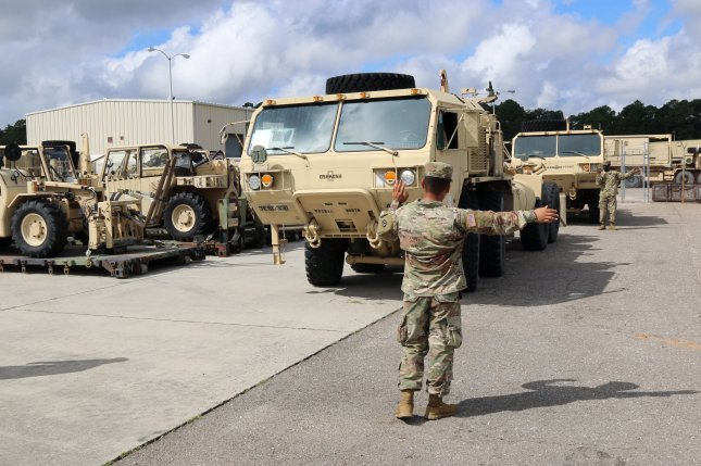 A 3rd Expeditionary Sustainment Command soldier lines up vehicles in preparation for Hurricane Florence at Fort Bragg, N.C., on Sept. 12, 2018. Photo by Staff Sgt. Terrance Payton/U.S. Army