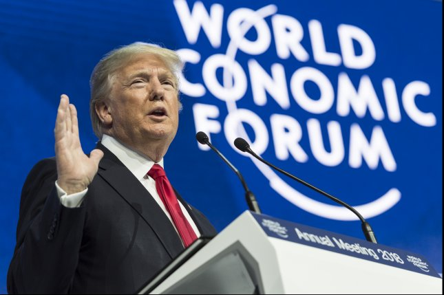 Trump the salesman urges Davos to stop worrying and buy American