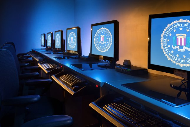 A row of computers is seen at the FBI's Jacksonville, Fla., field office, where detectives are investigating an ongoing cyberattack targeting the city of Pensacola where a mass shooting occurred Friday. File Photo courtesy U.S. Federal Bureau of Investigation