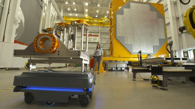 Raytheon on Wednesday received a contract for continued production and integration of the AN/SPY-6(V) radar. Pictured, a robot and engineer work on assembling an array for the system. Photo courtesy of Raytheon