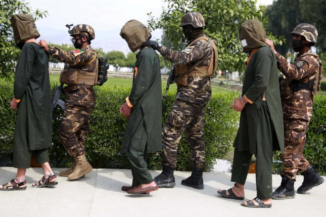 Afghan security officials show a group of suspected militants accused of planning attacks on government and security forces, in Jalalabad, Afghanistan on March 10. File Photo by Ghulamullah Habibi/EPA-EFE