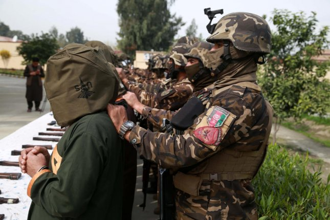 Afghan security officials show a group of suspected Taliban militants in Jalalabad, Afghanistan, on March 10. File Photo by Ghulamullah Habibi/EPA-EFE