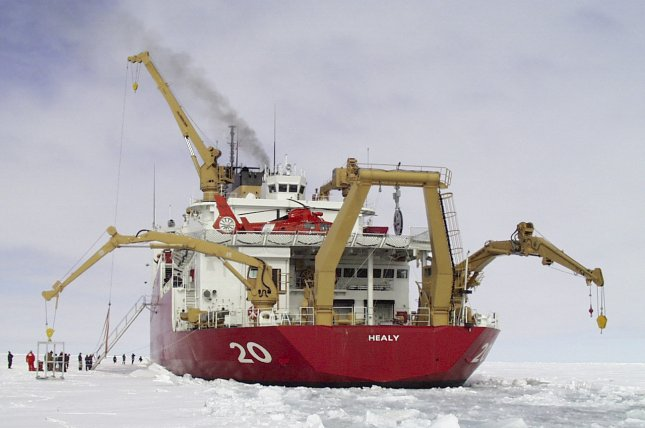 The Coast Guard Cutter Healy breaks ice in the Arctic Ocean. The defense bill under consideration in the U.S. Senate this week calls for a military Arctic port. Photo by U.S. Coast Guard
