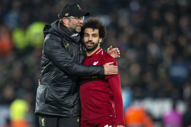Liverpool's head coach Juergen Klopp (L) embraces Mohamed Salah after the UEFA Champions League Group C soccer match between Liverpool FC and SSC Napoli held on Tuesday at Anfield in Liverpool, Britain. Photo by Peter Powell/EPA-EFE