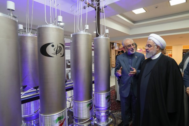 Iranian President Hassan Rouhani and nuclear energy chief Ali Akbar Salehi inspect a plant in Tehran on April 9, 2019. Salehi was targeted with new U.S. sanctions on Thursday. File Photo by Iranian Presidency Office/EPA-EFE
