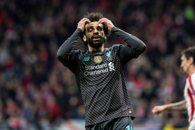 Mohamed Salah and Liverpool will have to wait to clinch the Premier League title after Manchester City beat Arsenal Wednesday in Manchester, England. Photo by Rodrigo Jimenez/EPA-EFE