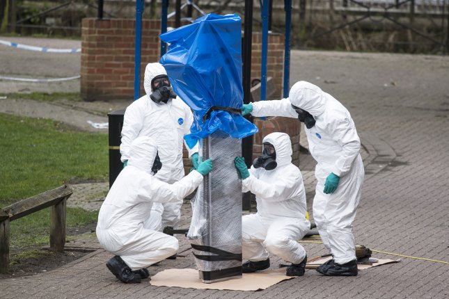 Army officers remove the bench where Sergi Skripal and his daughter Yulia Skripal were found after being poisoned using the Russian nerve agent Novichok in March. The United States announced Wednesday it will impose new sanctions on Russia for the attack later this month. File Photo by Will Oliver/EPA