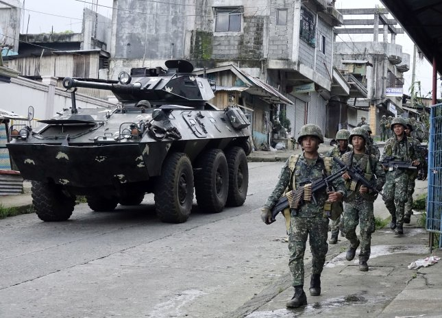 Philippine troops raise flag as bombs fall on Islamist-held city