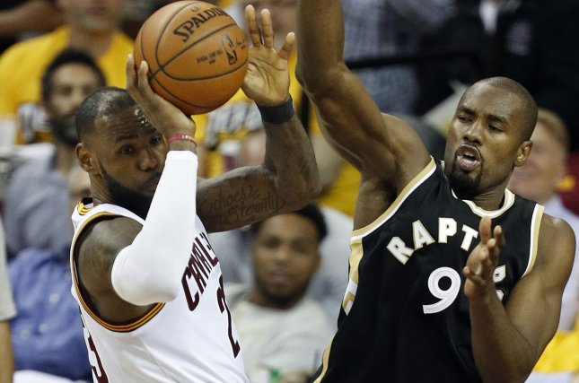Cleveland Cavaliers forward LeBron James (L) passes the ball as he is defended by Toronto Raptors forward Serge Ibaka (R) during the second half of Game 2 of the NBA Eastern Conference Semifinals on May 3 at Quicken Loans Arena in Cleveland. Photo by David Maxwell/EPA