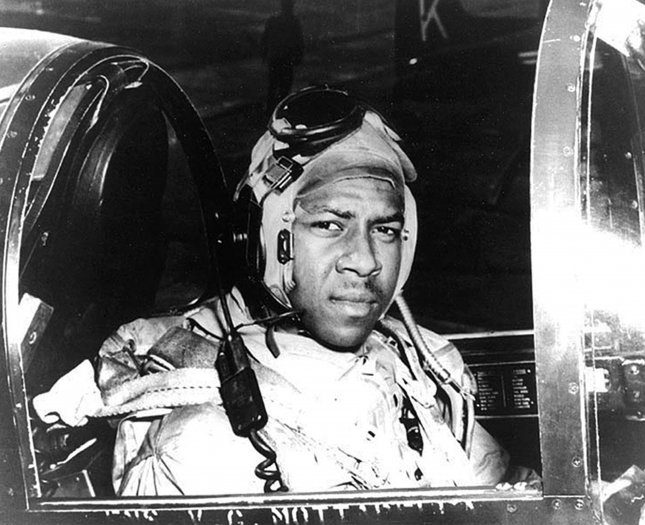 Ensign Jesse L. Brown, USN In the cockpit of an F4U-4 Corsair fighter, circa 1950. He was the first African-American to be trained by the Navy as a Naval Aviator, and such, became the first African-American Naval Aviator to see combat. Brown flew with Fighter Squadron 32 (VF-32) from USS Leyte (CV-32). File Photo by U.S. Navy/UPI