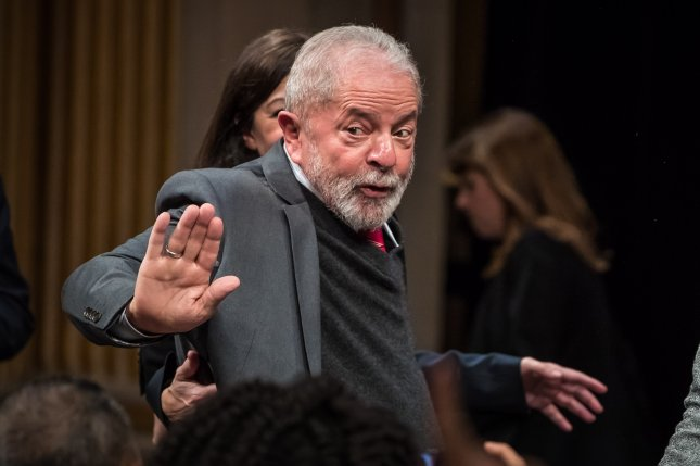 Former Brazilian President Luiz Inacio Lula da Silva waves while participating in a ceremony in his honor in Paris on March 2, 2020. File photo by Christophe Petit Tesson/EPA-EFE