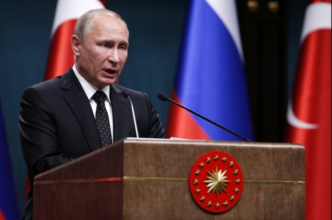The economy under Russian President Vladimir Putin sees inflationary pressures starting to ease, its Central Bank said. File photo by Tumay Berkin/EPA-EFE