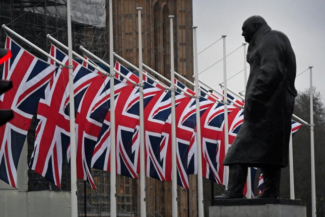 Union flags line Parliament Square behind a statue of former British Prime Minister Winston Churchill in London. File Photo by Andy Rain/EPA EFE